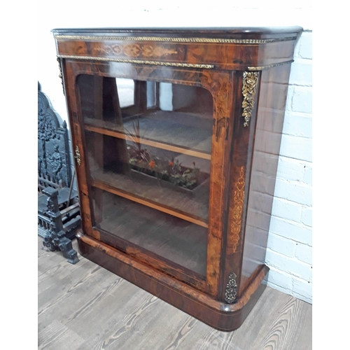 93 - A Victorian gilt brass mounted burr and figured walnut glazed dwarf bookcase of rectangular form wit...