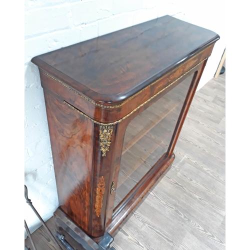 93 - A Victorian gilt brass mounted burr and figured walnut glazed dwarf bookcase of rectangular form wit...