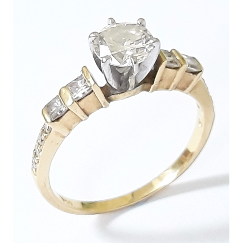 101 - A diamond solitaire ring, the central round brilliant cut 0.70ct diamond in 6 point claw setting, di...