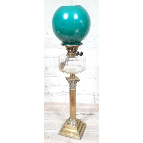 52 - A brass Corinthian column oil lamp with green glass shade and glass funnel, height 82cm....