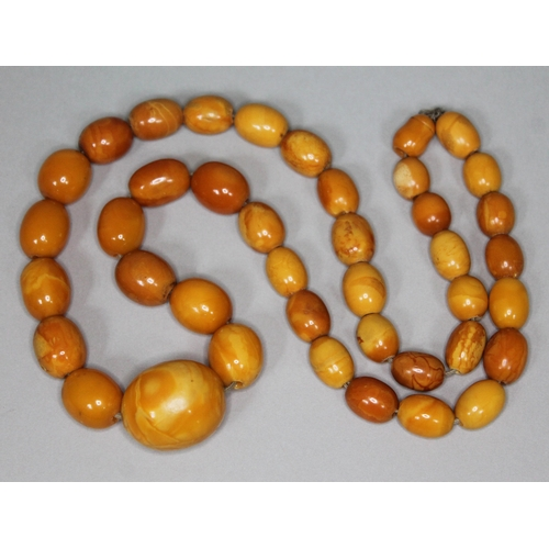 166 - A butterscotch amber bead necklace, beads ranging from 10mm - 24mm, length 56cm, gross wt. 41g....