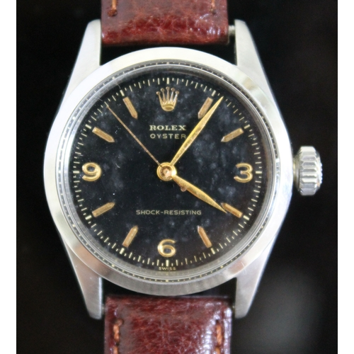 216 - A vintage Rolex Oyster Shock-Resisting stainless steel wristwatch circa 1955, black dial with gold h...