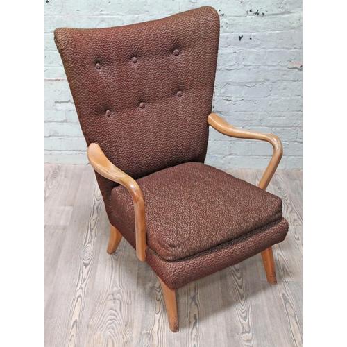 32 - A retro lounge chair, width 68cm, 75cm & height 97cm.
