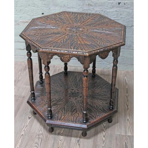 34 - An Edwardian carved oak octagonal two tier table, diam. 80cm & height 74cm.