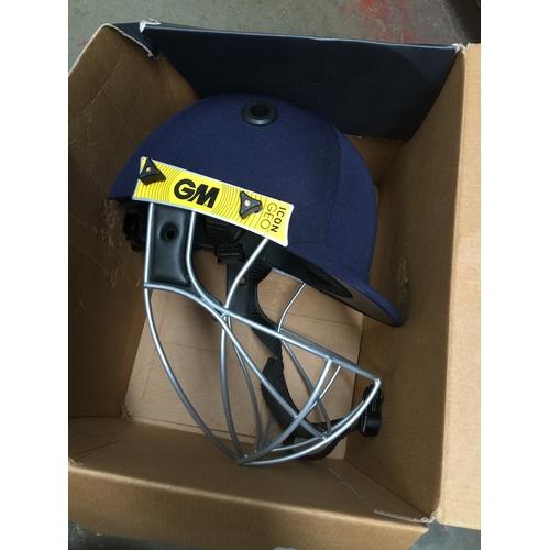 32 - An Icon Geo cricket helmet...