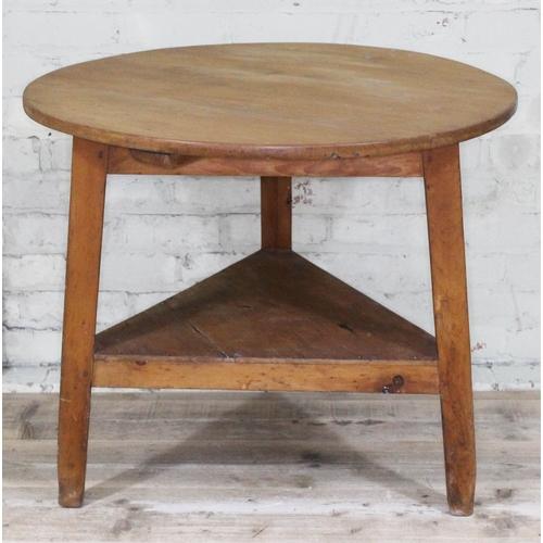 10 - A 19th Century pine cricket table, diam. 85.5cm & height 72cm....