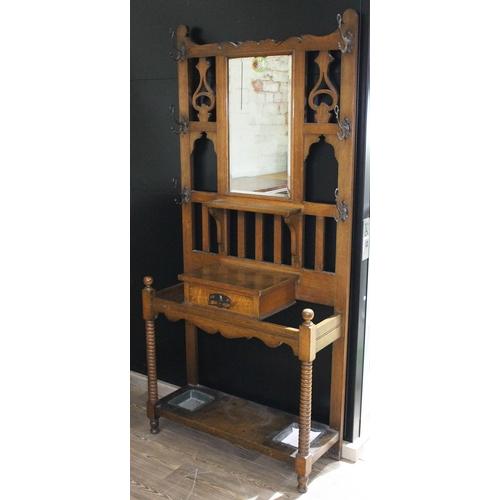 12 - A late Victorian oak hall stand, width 92cm, depth 35cm & height 198cm....