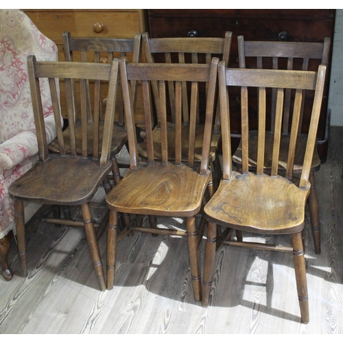 15 - A set of six elm and beech country kitchen chairs....