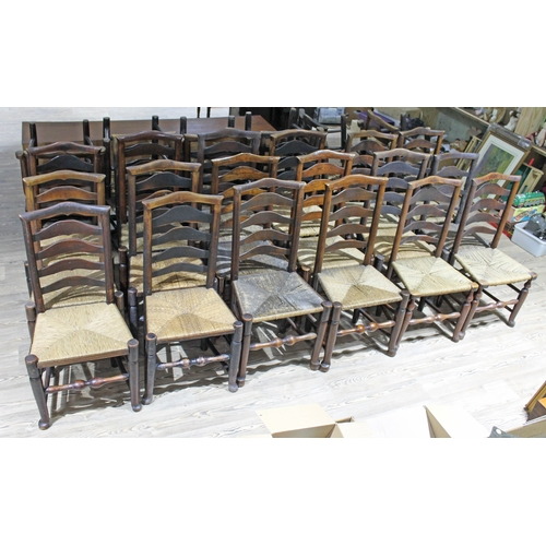 16 - A matched set of 29 Billinge rush seated ladder back chairs....