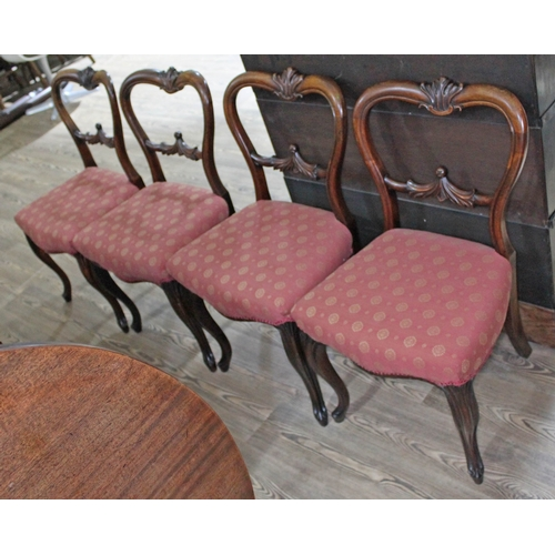 24 - A set of four Victorian rosewood chairs....