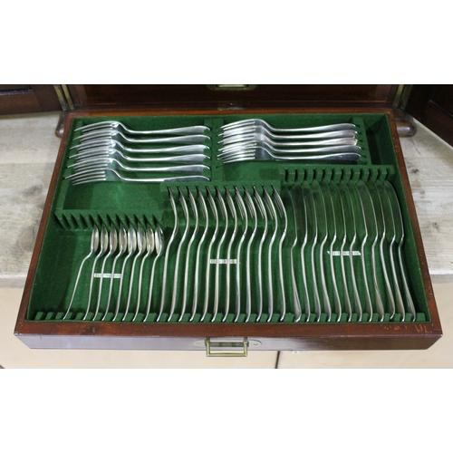 27 - A Victorian mahogany canteen comprising a part set of EPNS cutlery....