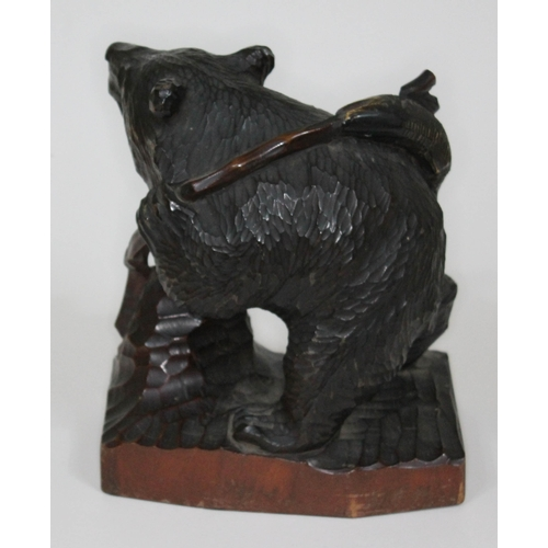 33 - A Japanese carved bear with fishing rob and salmon, height 25cm....