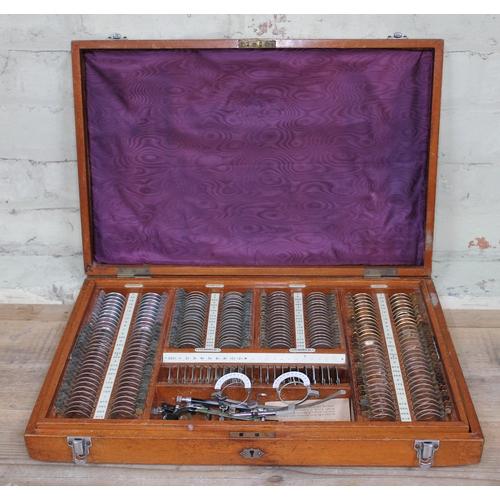 39 - A cased set of optometrist's lenses labelled 'American Optical Company Southbridge Mass. USA'....