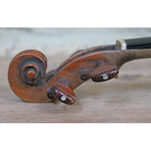 73 - A 19th century German violin, length of back 14
