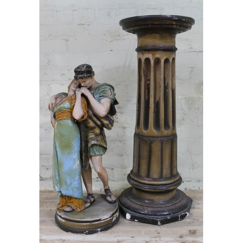 9 - A plaster figurine depicting a couple embracing with matching plinth, height 159cm....