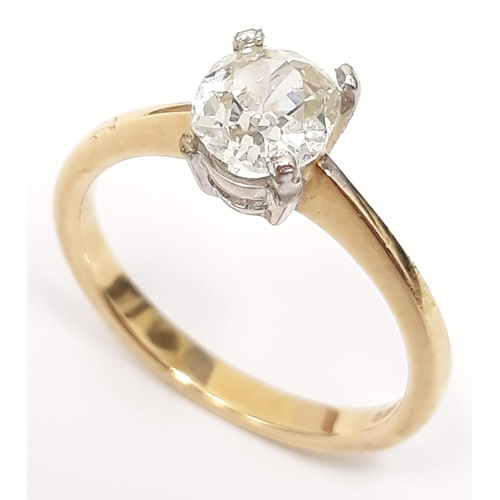 100A - A single stone diamond ring, the oval cut stone approx. wt. 1 carats, band hallmarked 18ct gold, gro...