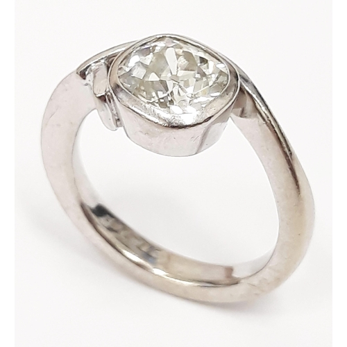 100B - A single stone diamond ring, the rectangular cut stone approx 1.5 carats, band hallamrked 18ct white...