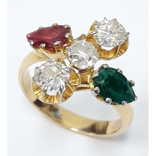 100C - A diamond ruby and emerald cluster ring, the three central stones approx. 0.30 carats each,band unma...
