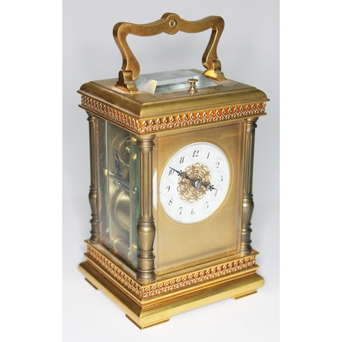 11 - A French late 19th century gilt brass carriage clock, 8 day repeating movement striking on single go...