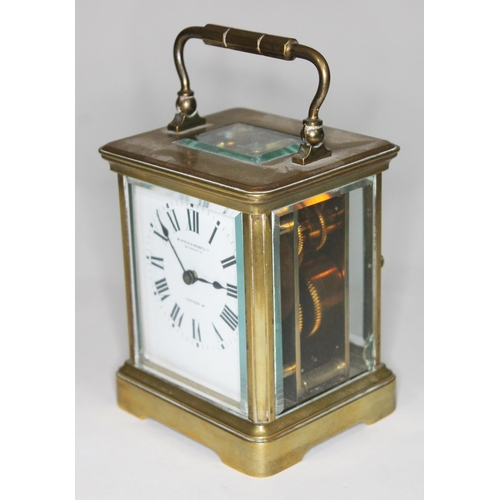 12 - An early 20th century brass carriage clock, the enamel dial having Roman Numerals and inscribed Mapp...