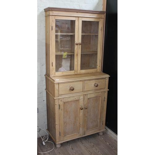 13 - A pine cabinet bookcase, width 86cm, depth 42cm & height 190cm....