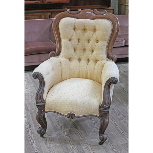 16 - A Victorian walnut armchair with scroll arms and feet, width 75cm, depth 78cm & height 115cm....