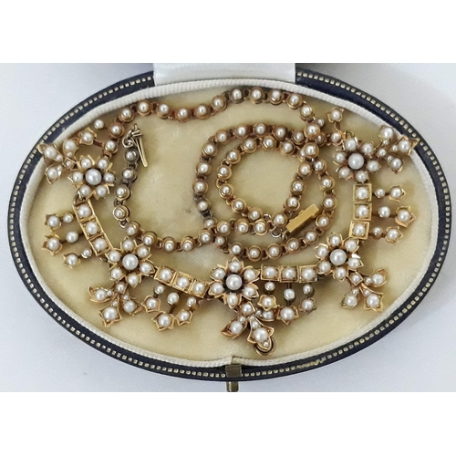 161 - A Victorian gold and pearl necklace, length 41cm, gross weight 28.4g, with associated box....