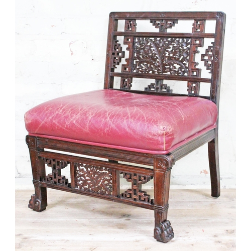 2 - An Oriental style low chair circa 1900 with red leather seat, Chinese style pierced back and frieze,...