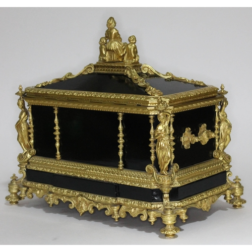 20 - A French 19th century gilt metal and ebonised casket having figural finial and columns, scroll work ...