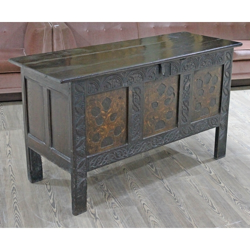 21 - A 17th century oak coffer, three piece plank top, the front with carved detail and marquetry inlaid ...
