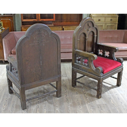 22 - A pair of oak church armchairs, the reverse of each inscribed 'Presented to St Thomas Church Preston...