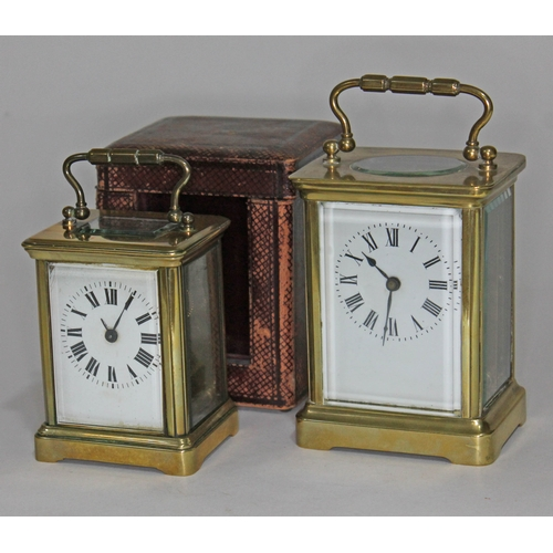 23 - Two brass carriage clocks, heights 12cm & 14cm, one with leather case....
