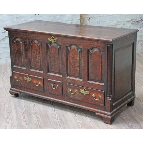 24 - A Georgian Lancashire oak mule chest, hinged lift top, five arched panelled front, fluted quarter co...