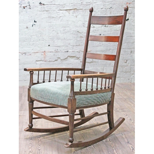 25 - A William Birch Arts & Crafts rocking chair, possibly retailed by Liberty & Co, width 67cm, depth 77...