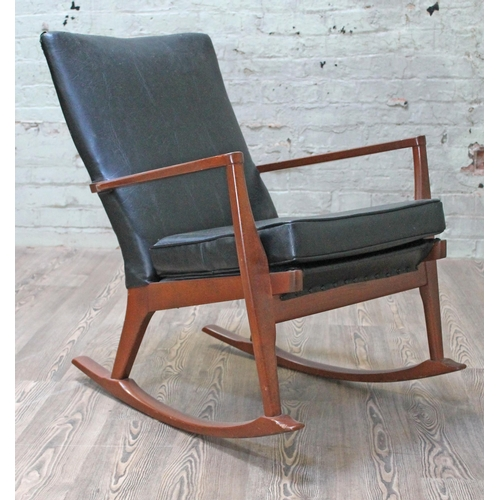 26 - A Parker Knoll rocking armchair. (This item may not comply with the Furniture and Furnishings (Fire)...