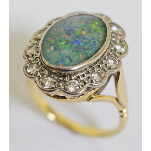 264 - An opal doublet and diamond ring, the central stone approx. 13mm x 9mm, band marked '18ct', gross we...