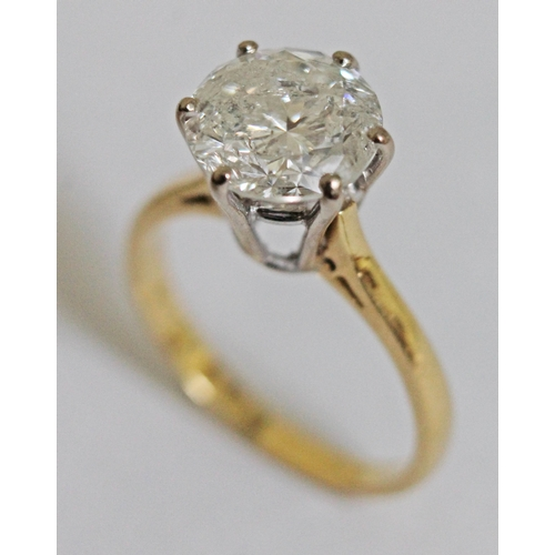 267 - A diamond solitaire ring, the six point claw set stone approx. 2.52 carats, band marked '18ct', gros...
