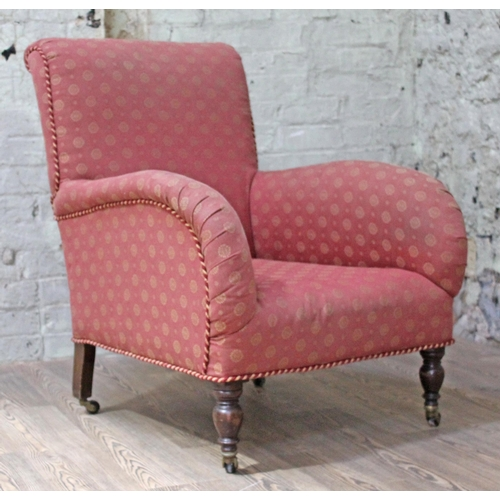 29 - A Victorian Howard & Sons style armchair with scroll back and curved arms, turned front legs and spl...