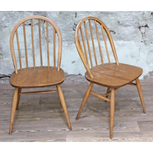 32 - A pair of Ercol blonde elm and beech chairs....