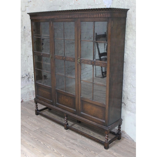 36 - A Waring & Gillow glazed oak bookcase, width 160cm, depth 37cm & height 176cm....