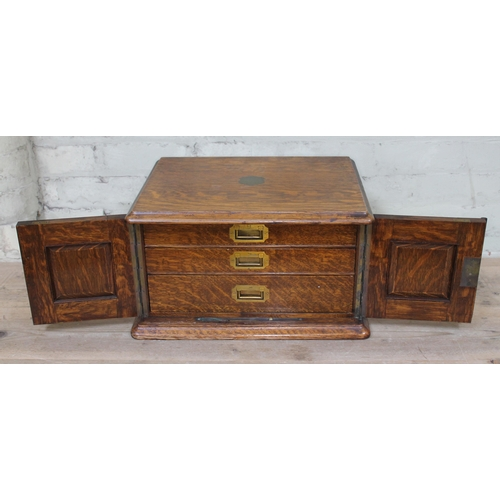 38 - A late 19th century oak canteen of silver plated cutlery, width 46cm....
