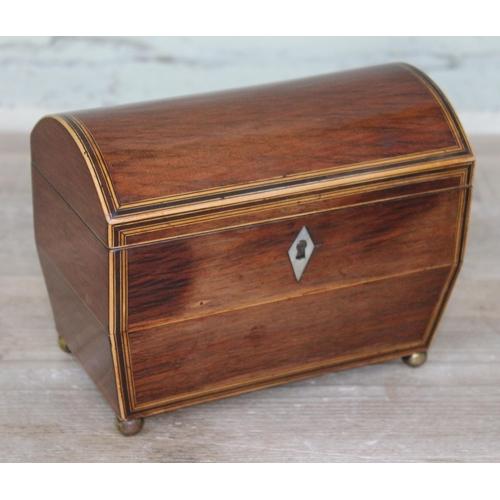 40 - A Georgian domed top box wood strung mahogany tea caddy with brass ball feet, length 18.5cm....