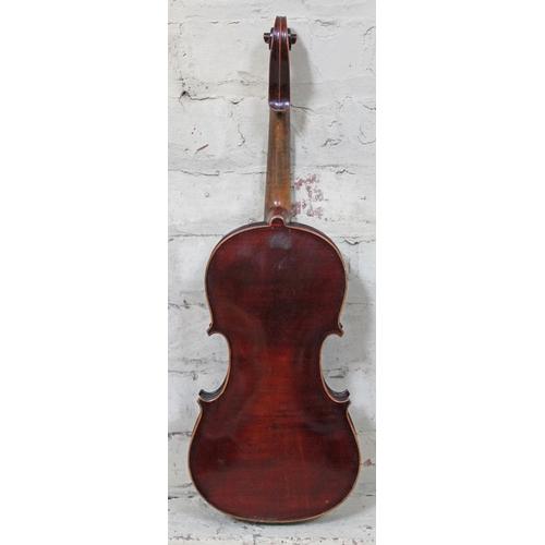 41 - A violin circa 1900, bearing Stradivarius label, length 36cm, with hard case....