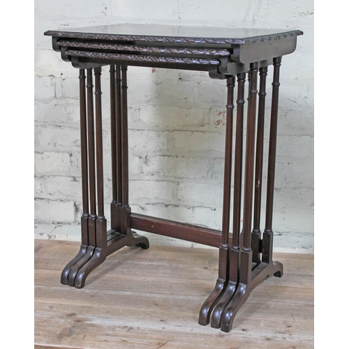 46 - A mahogany nest of tables with turned legs and carved top edge, height 70cm, width 56cm, depth 41cm....