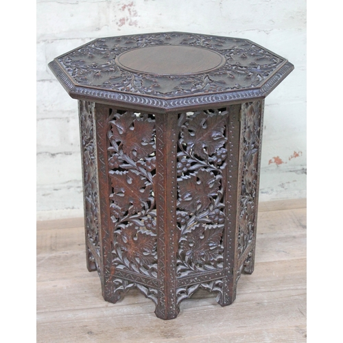 47 - A Persian carved hardwood octagonal table, height 40cm, width 38cm...