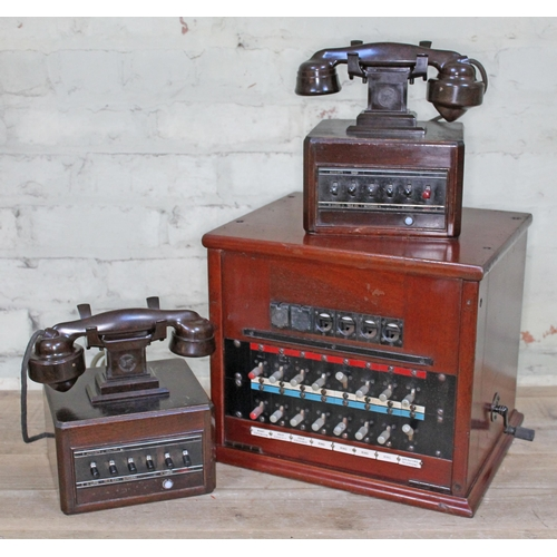 6 - An internal telephone system with exchange box and a pair of bakelite telephones with moulded name '...
