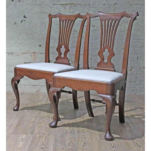 64 - A pair of Georgian red walnut chairs....