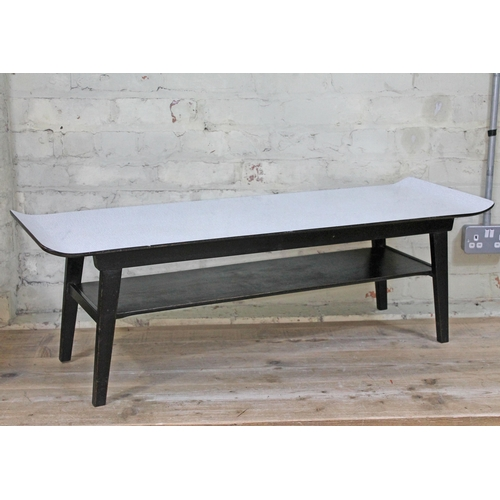 7 - A retro grey formica top coffee table with black legs, length 102cm....