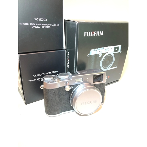425 - A Fujifilm X100T digital camera, with box, CD, manual, charger, strap, cables, battery and spare bat...