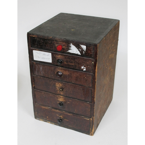 97 - File drawers containing clock/watch parts....